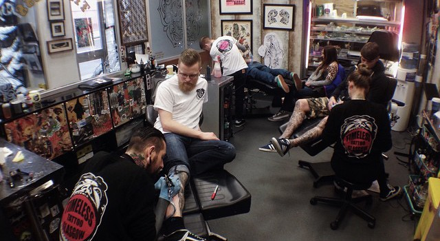 Busy day today in the shop come in and book in timeless for Tattoo and piercing shops in tulsa ok